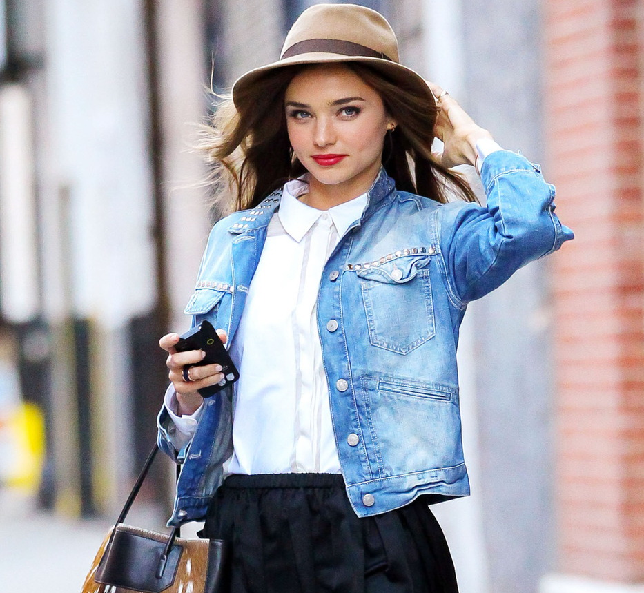 Victoria's Secret model Miranda Kerr holds onto her hat in windy New York City as she goes out with her dog Frankie