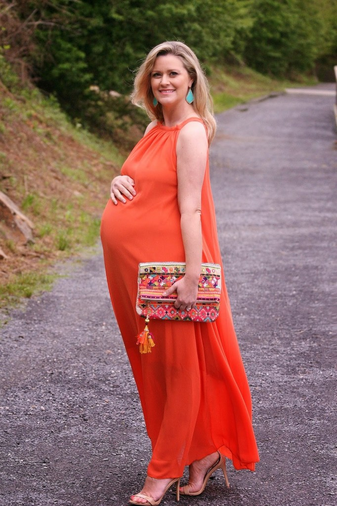 49b5fc003432e فستان حوامل أنيق للسهرات  فستان سهرة للحامل باللون البرتقالي المبهج ...