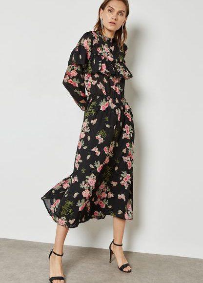 تصميم فستان اسود بأكمام طويلة