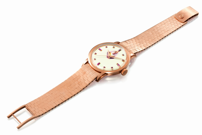 Lot 22 - Patek Philippe - Reference 2481, made in 1957 -A pink gold and ruby-set wristwatch with enamel dial featuring a portrait of King lbn Saud Est. $45,000-65,000 (2)