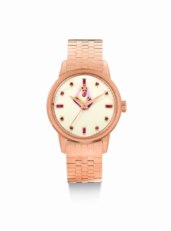 Lot 22 - Patek Philippe - Reference 2481, made in 1957 -A pink gold and ruby-set wristwatch with enamel dial featuring a portrait of King lbn Saud Est. $45,000-65,000