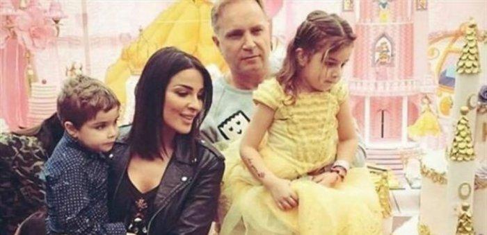 نادين مع زوجها السابق وطفليها هيفن وجيوفاني