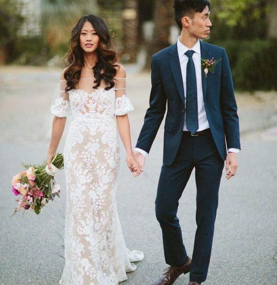 فستان زفاف باكمام منسدله