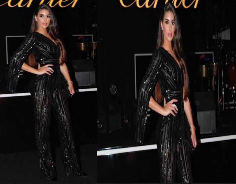 ياسمين صبري ترتدي جمبسوت سواريه باللون الأسود
