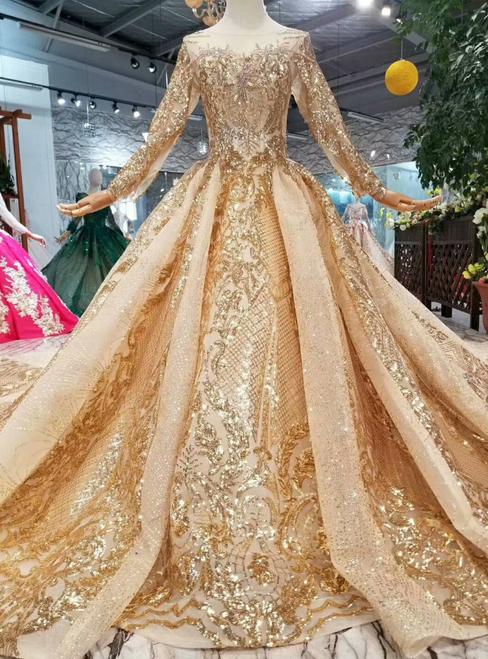 تصميم فخم لفستان زفاف من لون الشامبين
