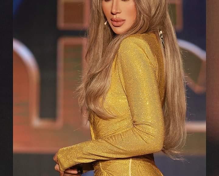 مايا دياب بفستان أنثوي مثير باللون الأصفر المستطردة وأكمام طويلة