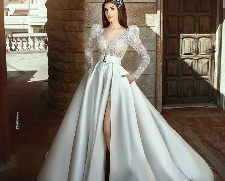 تصميم ناعم لفستان زفاف بكم طويل