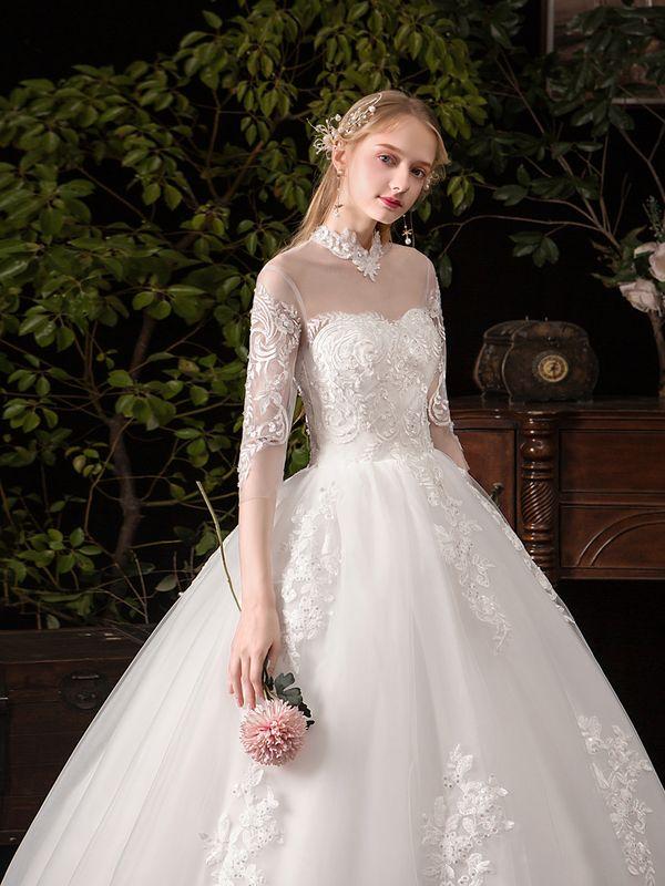 فساتين زفاف بأكمام متوسطة الطول